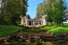 Summer landscape of the Pavlovsk garden, Apollo Colonnade. Summer landscape of the Pavlovsk garden, Russia. Viewl to the Apollo Colonnade pavilion Royalty Free Stock Photography