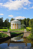 Summer landscape of the Pavlovsk garden. Temple of Friendship. Summer landscape of the Pavlovsk garden, Russia. View from the pool to the temple of Friendship Royalty Free Stock Image