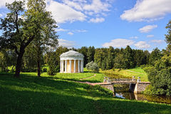 Summer landscape of the Pavlovsk garden. Temple of Friendship. Summer landscape of the Pavlovsk garden, Russia. View from the pool to the temple of Friendship Royalty Free Stock Photos