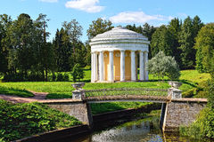 Summer landscape of the Pavlovsk garden. Temple of Friendship. Summer landscape of the Pavlovsk garden, Russia. View from the pool to the temple of Friendship Stock Photos