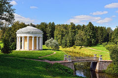 Summer landscape of the Pavlovsk garden. Temple of Friendship. Summer landscape of the Pavlovsk garden, Russia. View from the pool to the temple of Friendship Stock Image
