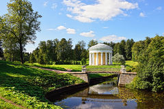 Summer landscape of the Pavlovsk garden. Temple of Friendship. Summer landscape of the Pavlovsk garden, Russia. View from the pool to the temple of Friendship Royalty Free Stock Photo
