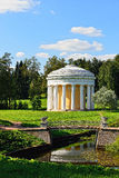 Summer landscape of the Pavlovsk garden. Temple of Friendship. Summer landscape of the Pavlovsk garden, Russia. View from the pool to the temple of Friendship Royalty Free Stock Photography