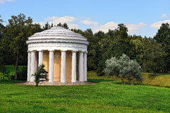 Summer landscape of the Pavlovsk garden, Temple of Friendship. Summer landscape of the Pavlovsk garden, Russia. View to the temple of Friendship pavilion Stock Photos