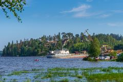 Summer landscape with pier and small harbour in northern village. Ladoga lake bay in sunny day. Beautiful rural scenery, travel. Blog concept. Lahdenpohja stock photography