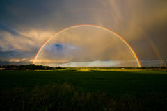 Summer landscape with rainbow Royalty Free Stock Photo