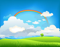 Summer landscape with a rainbow Stock Image