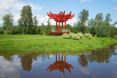 A summer landscape with a red japanese arbor. Estate Maryino,  Leningrad region. ANDRIANOVO, RUSSIA - JULY 31, 2016: A summer landscape with a red japanese arbor Royalty Free Stock Photos