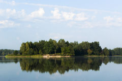 Summer Landscape. Reflection of the sky and trees in the water Royalty Free Stock Image