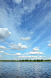 Summer landscape with river and cloudy sky Stock Photography