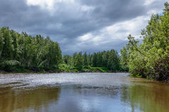 Summer landscape with river and forest in a thunderstorm day Royalty Free Stock Photo