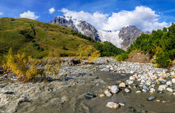 Summer landscape with river and mountain snow. Stock Photos