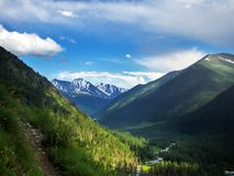 Summer landscape with river and mountain snow. royalty free stock images