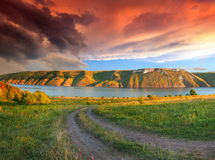Summer landscape with the river in the mountains. Sunse Stock Photography