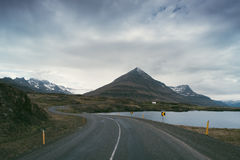 Summer landscape with road and mountains in Iceland Stock Images