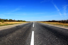 Summer landscape with road and sky. Summer landscape with line of road and blue sky Royalty Free Stock Photo