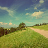 Summer landscape with road - vintage retro style Stock Photos