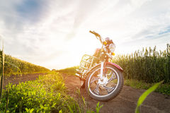 Summer landscape road, wheat field, motocycle. And blue clouds Stock Images