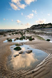 Summer landscape with rocks on beach during late evening and low Royalty Free Stock Photos