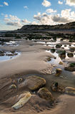 Summer landscape with rocks on beach during late evening and low Stock Photo