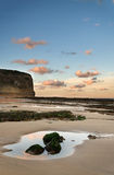 Summer landscape with rocks on beach during late evening and low Royalty Free Stock Image