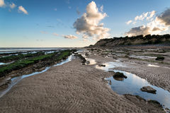Summer landscape with rocks on beach during late evening and low Royalty Free Stock Photography