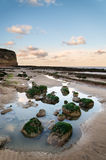 Summer landscape with rocks on beach during late evening and low Royalty Free Stock Images