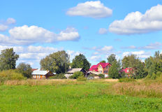 Summer landscape with russian village. Stock Images