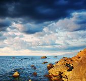 Summer landscape with the sea and the cloudy sky. Stock Image
