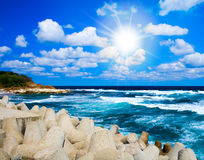 Summer landscape: sea waves, blue sky and sun Stock Photos