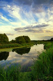 Summer landscape with the sky and clouds reflecting in the river. Summer landscape with the sky and clouds reflecting in the surface of the  river Royalty Free Stock Photos