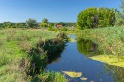 Summer landscape with small river Merla in Mala Rublivka village, Poltavskaya oblast, Ukraine stock photo