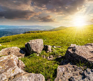 Summer landscape with stones on the hill at sunset Stock Images