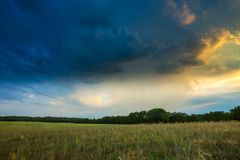 Summer landscape with stormy sky over fields Stock Image
