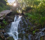 Summer landscape with sun and a waterfall in the Carpathians Royalty Free Stock Images
