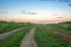 Summer  landscape with sunrise, fog and the road Royalty Free Stock Photography