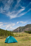 Summer landscape with a tent in the mountains of Altai. Tent in the Altai Mountains.Tourism. Journey. Trevel Royalty Free Stock Images