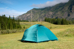 Summer landscape with a tent in the mountains of Altai. Tent in the Altai Mountains.Tourism. Journey. Trevel Stock Photo