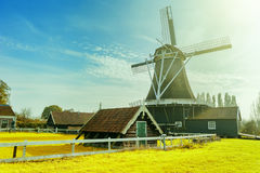 Summer landscape with traditional dutch windmill. Old farm concept Stock Photography