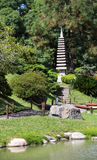 Japanese garden in the summer.Stone traditional tower. Royalty Free Stock Photography