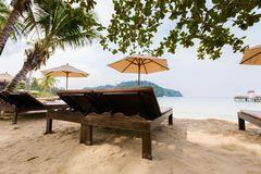 Tropical landscape of Koh Kood. Summer landscape on tropical koh Kood island in Thailand. Landscape with sunbeds taken on Bang Bao beach Stock Photography