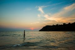 Tourist sunset on Koh Kood. Summer landscape on tropical koh Kood island in Thailand. Young caucasian woman on white sand beach with coconut palms during Royalty Free Stock Photography