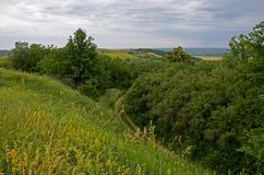 Summer landscape with unpaved roads among high green hills stock images
