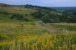 Summer landscape with unpaved roads among high green hills royalty free stock photos