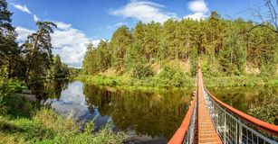 summer landscape at the Ural river with the Irtysh river suspension bridge, Russia Stock Images