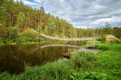 Summer landscape at the Ural river with the Irtysh river suspension bridge, Russia Stock Photos