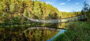 Summer landscape at the Ural river with the Irtysh river suspension bridge, Russia Stock Image