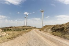 Summer landscape and wind turbines farm - Renewable Energy. A summer landscape and wind turbines farm - Renewable Energy Stock Photos