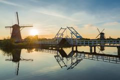 Summer landscape with windmills and bridge in the Netherlands Royalty Free Stock Photos