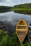 Summer landscape with wooden  fishing boats by the lake. Old wooden fishing boats by the lake, Lithuania. Europe. Summer landscape.Old wooden fishing boats near Stock Photo